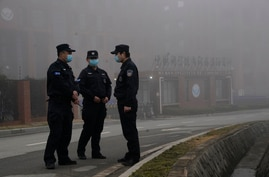 Security personnel stand guard near the Wuhan Institute of Virology after a World Health Organization team arrived for a field…