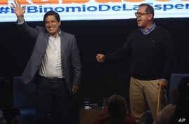 Esperanza-UNES- alliance party presidential candidate Andres Arauz, left, and his running mate Carlos Rabascall celebrate as…