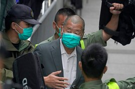 Democracy advocate Jimmy Lai leaves the Hong Kong's Court of Final Appeal, Tuesday, Feb. 9, 2021. The court on Tuesday denied…