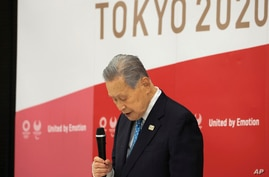 Tokyo 2020 Olympics organizing committee President Yoshiro Mori attends a meeting with council and executive board members at…