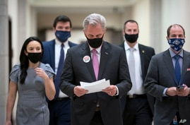 House Minority Leader Kevin McCarthy, R-Calif., arrives for a news conference at the Capitol in Washington, Friday, Feb. 26,…