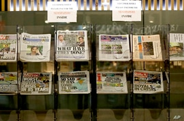 Newspapers headlining Prince Harry and Meghan's explosive TV interview are displayed for sale outside a shop in London, Tuesday…