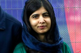 FILE - Malala Yousafzai, Pakistani Nobel Peace Prize winner, appears at the Cricket World Cup opening party along The Mall in…