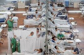 COVID-19 patients lie on beds at a field hospital built inside a sports coliseum in Santo Andre, on the outskirts of Sao Paulo,…