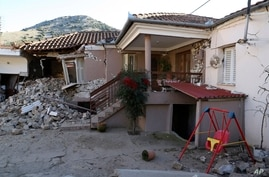 Damage is seen on a house after an earthquake in Damasi village, central Greece, Wednesday, March 3, 2021. An earthquake with a…