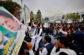 Supporters of the ruling Pakistan There-e-Insaf political party gather outside the National Assembly to celebrate Prime…