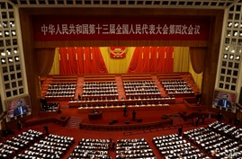 With screens showing Chinese President Xi Jinping,  delegates attend the opening session of China's National People's Congress …
