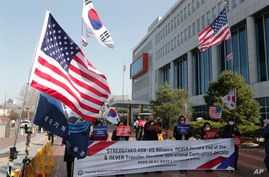 Protesters stage a rally welcoming the visit of U.S. Defense Secretary Lloyd Austin and Secretary of State Antony Blinken…