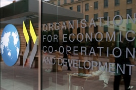 The logo at the entrance of the Organisation for Economic Co-operation and Development (OECD) headquarters in Paris, France,…