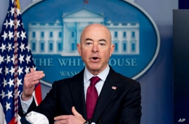 FILE - In this Monday, March 1, 2021 file photo, Homeland Security Secretary Alejandro Mayorkas speaks during a press briefing…