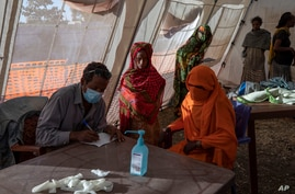 Tigray refugees who fled a conflict in the Ethiopia's Tigray region, receive treatment at a clinic run by MSF (Doctors Without…