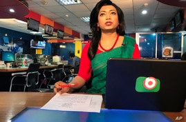 Bangladesh's first transgender news anchor Tashnuva Anan Shishir reads news bulletin , in Dhaka, Bangladesh, Tuesday, March 9,…