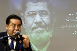 Egyptian politician Ayman Nour speaks during a press conference organised by Muslim Brotherhood for former Egyptian president…