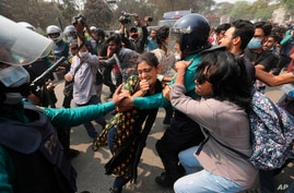 Bangladeshi students clash with police during a protest in Dhaka, Bangladesh, Monday, March 1, 2021. About 300 student…