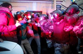 People clash with police during a protest in support of jailed opposition leader Alexei Navalny in St. Petersburg, Russia,…