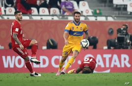 Bayern's Lucas Hernandez, left, is challenged by Tigres' Andre Gignac during the Club World Cup final soccer match between FC…