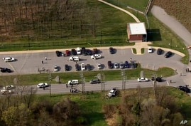 This photo provided by WJLA, police respond to the scene of a shooting in in Frederick, Md., on Tuesday, April 6, 2021.  Police…