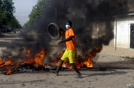 A boy protests on the street in N'Djamena, Chad, Tuesday, April 27, 2021. Thousands of people protested and two people were…