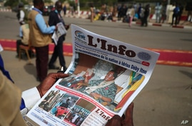 A journalist reads a local newspaper bearing the late Chadian president Idriss Deby on the front page, during the state funeral…