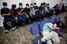 Young unaccompanied migrants wait for their turn at the secondary processing station inside the U.S. Customs and Border…