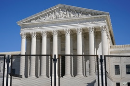Security fencing surrounds the Supreme Court building on Capitol Hill in Washington, Sunday, March 21, 2021. (AP Photo/Patrick…