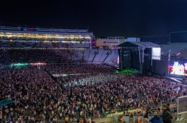 Fans fill the stadium as New Zealand band Six60 perform at Eden Park in Auckland, New Zealand, Saturday, April 24, 2021. Six60…