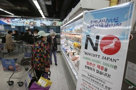 A notice denouncing the Japanese government's decision on releasing treated radioactive Fukushima water hangs at the seafood…