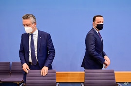 German Health Minister Jens Spahn, right, together with Lothar Wieler, head of Germany's Robert Koch Institute (RKI) for…
