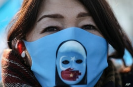 A protester from the Uyghur community living in Turkey, participates in a protest in Istanbul, Thursday, March 25, against…