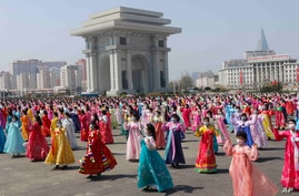Women dance near the Arch of Triumph on the Day of the Sun, the birth anniversary of late leader Kim Il Sung, in Pyongyang,…
