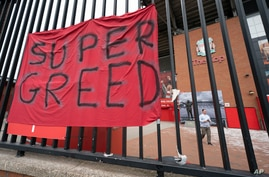 FILE - In this file photo dated Wednesday, April 21, 2021, a protest banner against the proposed Super League is seen outside…
