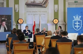 People attend a conference inaugurating a new conservative university, Collegium Intermarium, which aims to educate a new…