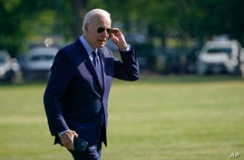 President Joe Biden walks off of Marine One on the Ellipse near the White House, Thursday, May 27, 2021, after returning from a…