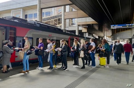 Passengers at a railway station in Minsk, Belarus, stand in line to board a high-speed train to Moscow on Friday, May 28, 2021…
