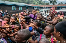 People who fled Goma, Congo, gather at a food distribution point Friday, May 28, 2021 in Sake, some 25 kms (16 miles) west of…