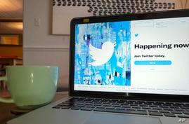 The login/sign up screen for a Twitter account is seen on a laptop computer Tuesday, April 27, 2021, in Orlando, Fla.