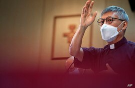 Stephen Chow Sau-yan prays after a press conference in Hong Kong Tuesday, May 18, 2021. Pope Francis on Monday named a new…