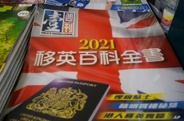 Copies of Next Magazine, owned by Jimmy Lai, are displayed for sale at a newsstand in Hong Kong, Monday, May 17, 2021. The Hong…