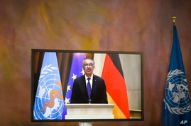 Director General of the World Health Organization Tedros Adhanom Ghebreyesus attends a virtual joint news conference with…
