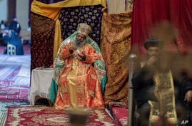FILE - In this April 17, 2020, photo, Abune Mathias, the 6th Patriarch of the Ethiopian Orthodox Church, uses hand…