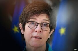 German Defense Minister Annegret Kramp Karrenbauer makes a statement as she arrives for a meeting of EU defense ministers at…