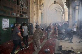Palestinians clash with Israeli security forces at the Al Aqsa Mosque compound in Jerusalem's Old City Monday, May 10, 2021…