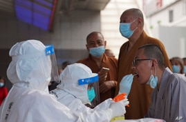 Monks get tested for the coronavirus in a district in Guangzhou in southern China's Guangdong province on Sunday, May 30, 2021…