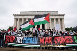 Supporters of the Palestinians rally during the National March for Palestine demonstration at Lincoln Memorial, in Washington,…