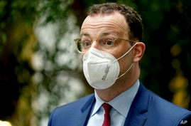 German Health Minister Jens Spahn arrives for a press conference in Berlin, Germany, Wednesday, May 12, 2021. (AP Photo/Michael…