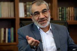 Spokesman of the Iran's Guardian Council Abbas Ali Kadkhodaei speaks in an interview with The Associated Press at his office in…