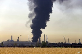 A dark plume of smoke rises up from a main oil refinery south of Tehran, Iran, Thursday, June 3, 2021. A massive fire broke out…