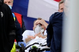Paramedics using a stretcher to take out of the pitch Denmark's Christian Eriksen after he collapsed during the Euro 2020…