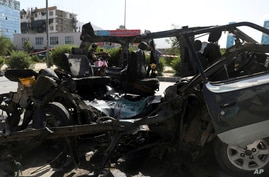 Afghan security personnel inspect the site of a bomb explosion in Kabul, Afghanistan, Thursday, June 3, 2021. Police say a bomb…