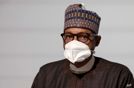 Nigeria's President Muhammadu Buhari poses before the opening session at the Summit on the Financing of African Economies…